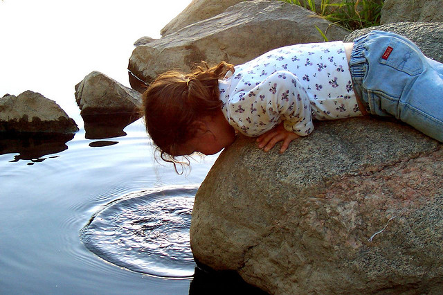 child looking at ripple effect