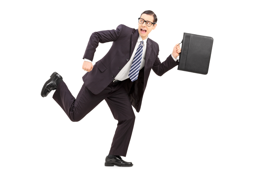 Scared male businessman running away from something